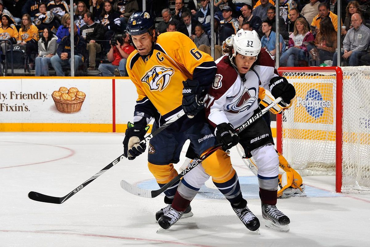 NASHVILLE, TN - MARCH 08:  Shea Weber #6 of the Nashville Predators skates against Steve Downie #27 of the Colorado Avalanche at Bridgestone Arena on March 8, 2012 in Nashville, Tennessee.  (Photo by Frederick Breedon/Getty Images)