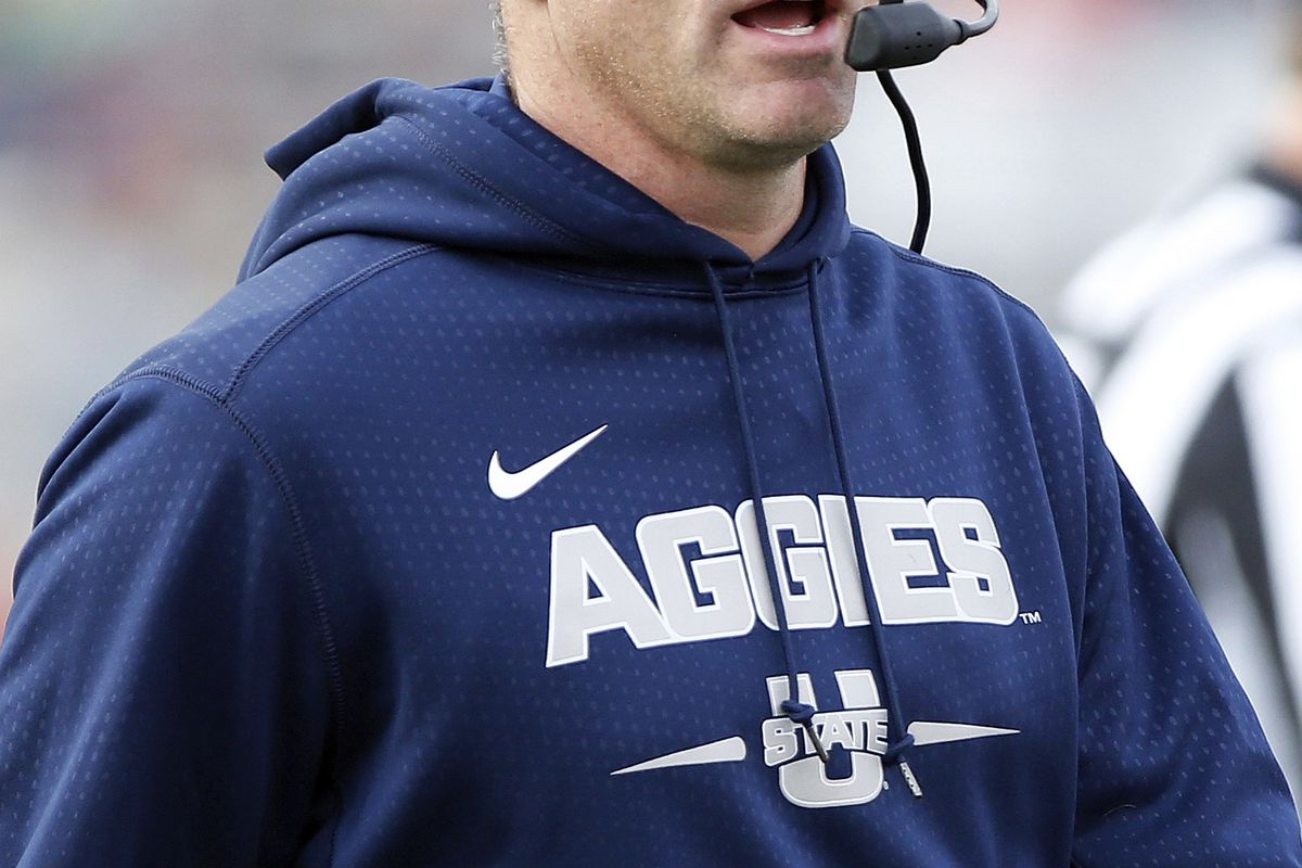 Utah State coach Matt Wells works the sidelines during the first half of an NCAA college football game against New Mexico in Albuquerque, N.M., Saturday, Nov. 4, 2017. (AP Photo/Andres Leighton)