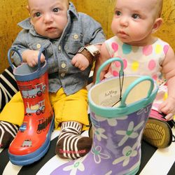 On Aiden: Brown and white striped socks and Hatley rubber rain boot with trains, $42 On Sloane: Hatley rubber rain boot with flowers, $42. Both from The Red Balloon Co.