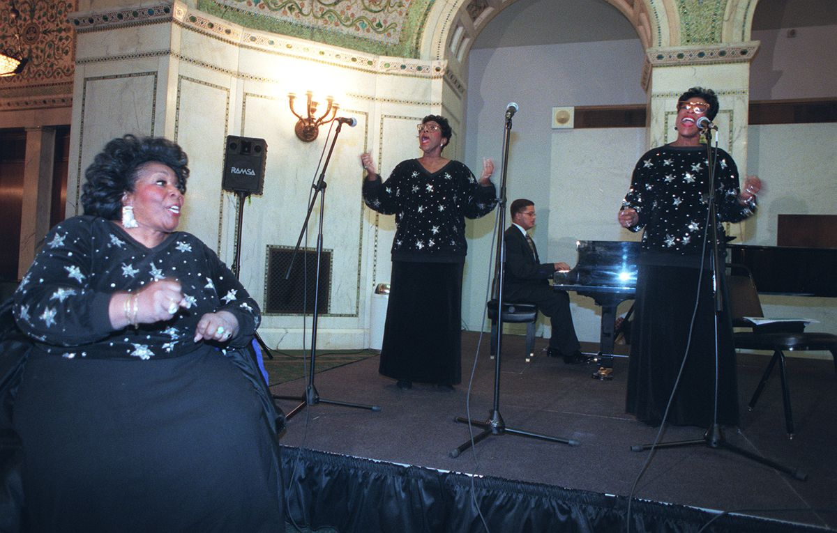 """The Barrett Sisters — from left, Delois Barrett Campbell, Rodessa Barrett Porter and Billie Barrett Greenbey — with Chip Johnson on piano, performing Feb. 1, 1998, at the Chicago Cultural Center during the kickoff of an African-American History Month festiva """"The Grand Ye Ye."""""""