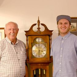 Calvin Adams stands with his grandson, Boman Farrer, who has followed his grandpa's footsteps in beginning a career in watchmaking.