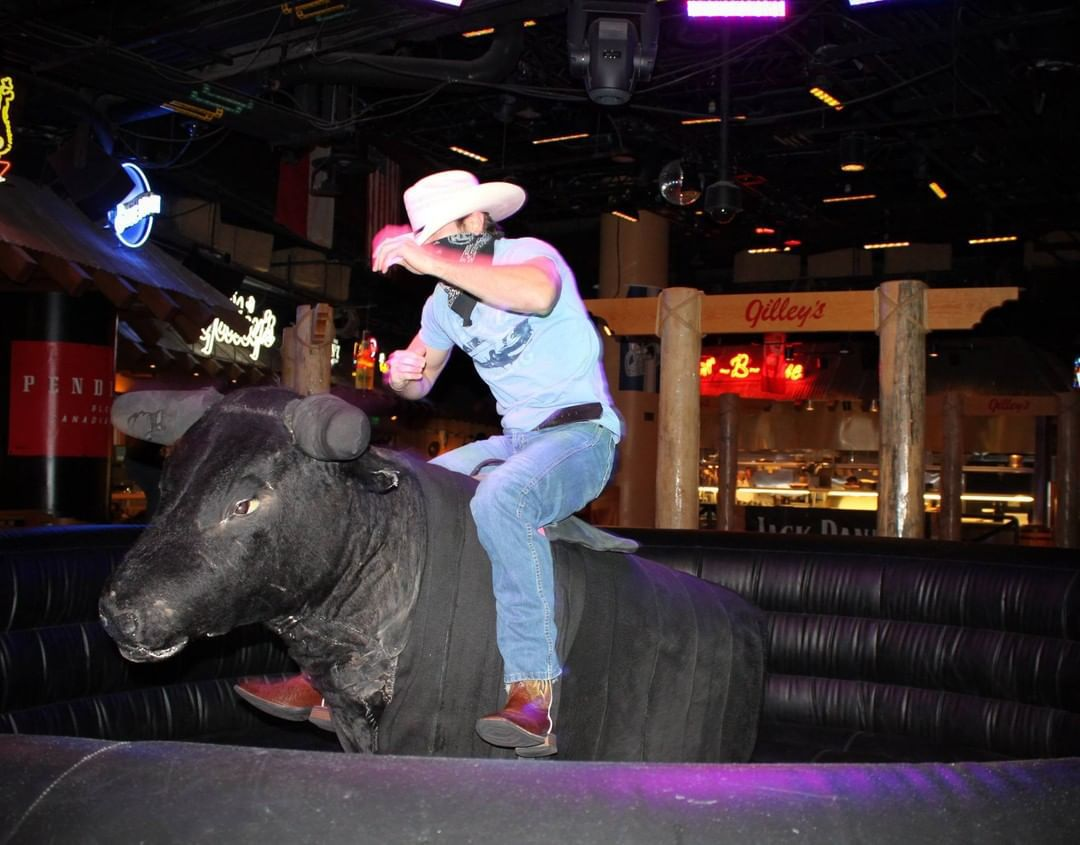 A man rides a mechanical bull