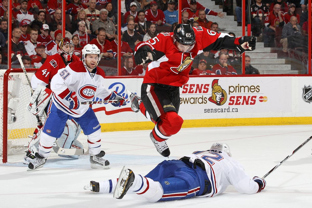 Erik Karlsson performs his famous Leg Drop finishing move to win the featherweight belt