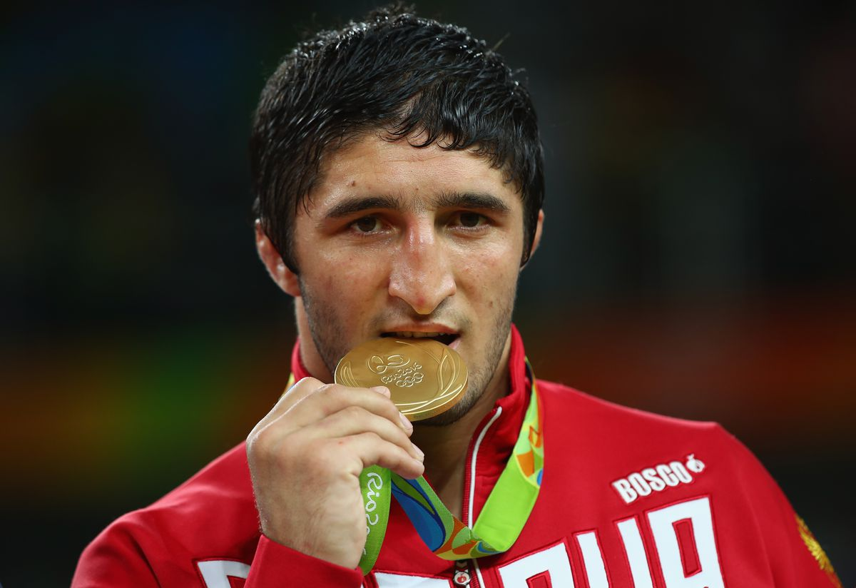 Abdulrashid Sadulaev celebrates with his gold medal at the 2016 Olympics.