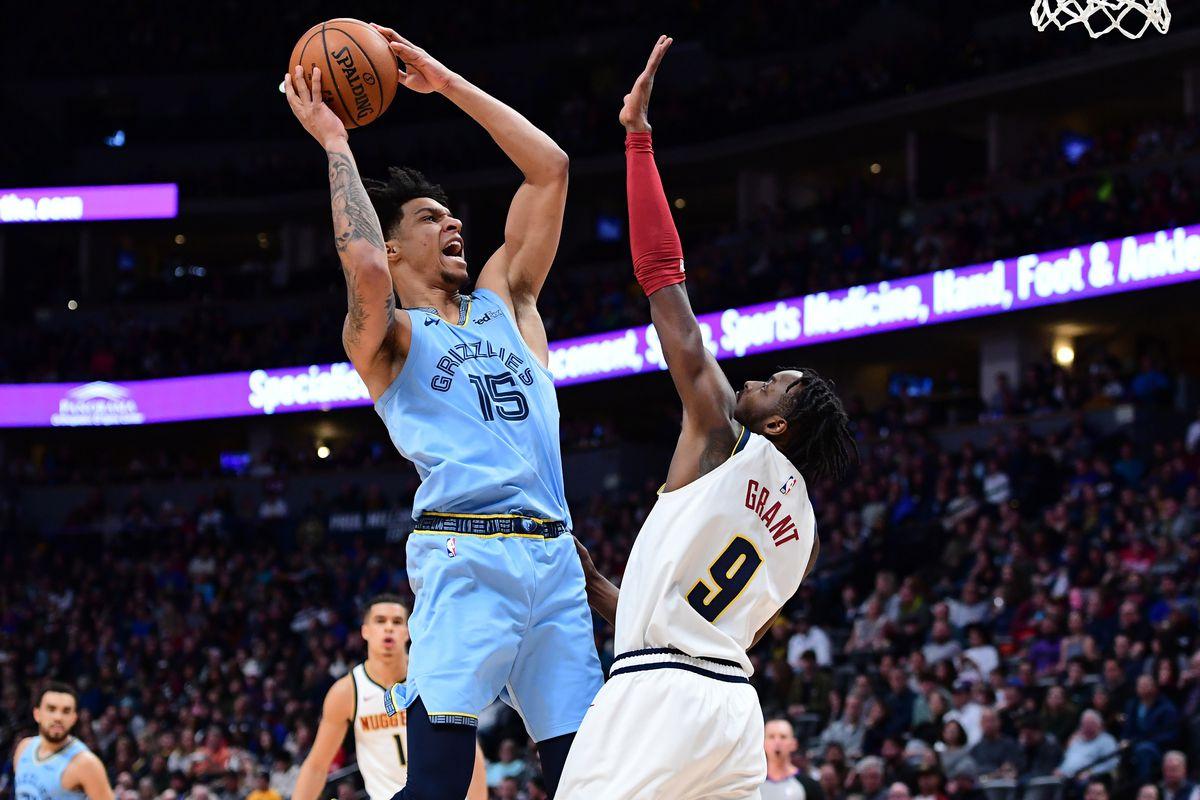 Memphis Grizzlies forward Brandon Clarke shoots over Denver Nuggets forward Jerami Grant in the first quarter at the Pepsi Center.