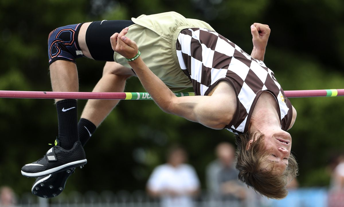 Kale Thomas, of Davis, clears the bar as he competes in the 6A high jump during the state high school track meet at BYU in Provo on Thursday, May 16, 2019.