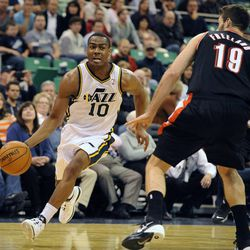 Utah Jazz point guard Alec Burks (10) drives to the basket as Portland Trail Blazers power forward Joel Freeland (19) closes in during the second half of a game at the Energy Solutions Arena on Wednesday, October 16, 2013.