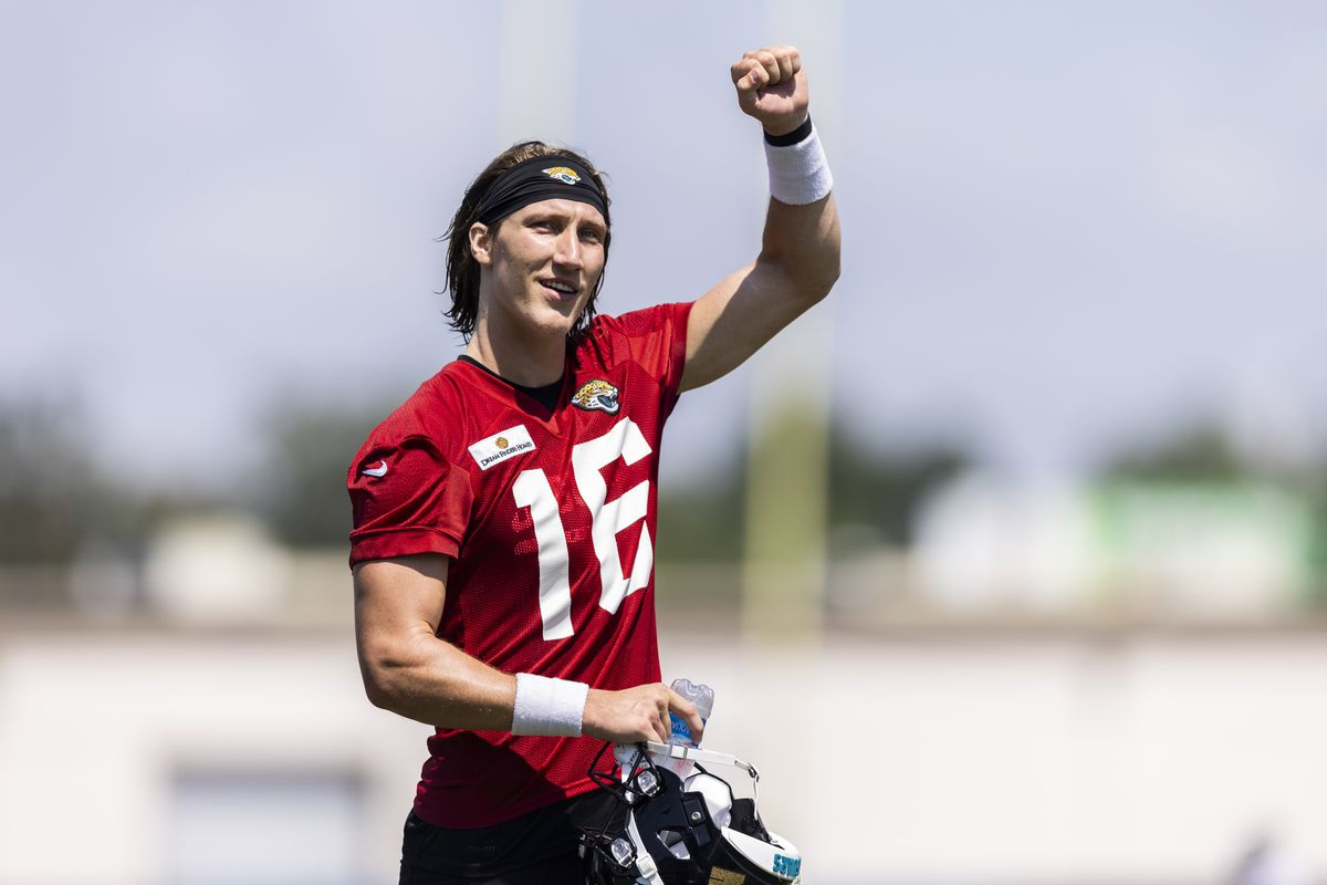 Trevor Lawrence #16 of the Jacksonville Jaguars waves to fans after Training Camp at TIAA Bank Field on July 30, 2021 in Jacksonville, Florida.