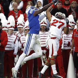 Utah defensive back Brandon Burton (27) and BYU wide receiver O'Neill Chambers go up for a pass during their game at LaVell Edwards Stadium in Provo Saturday. BYU won 26-23 in overtime.