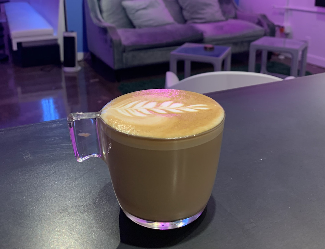 A latte sitting on a table at Lula.