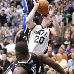 Utah Jazz guard Gordon Hayward (20) is called for an offensive foul as he crashes into Orlando's #11 Glen Davis as the Utah Jazz and the Orlando Magic play Saturday, April 21, 2012 in Energy Solutions arena.