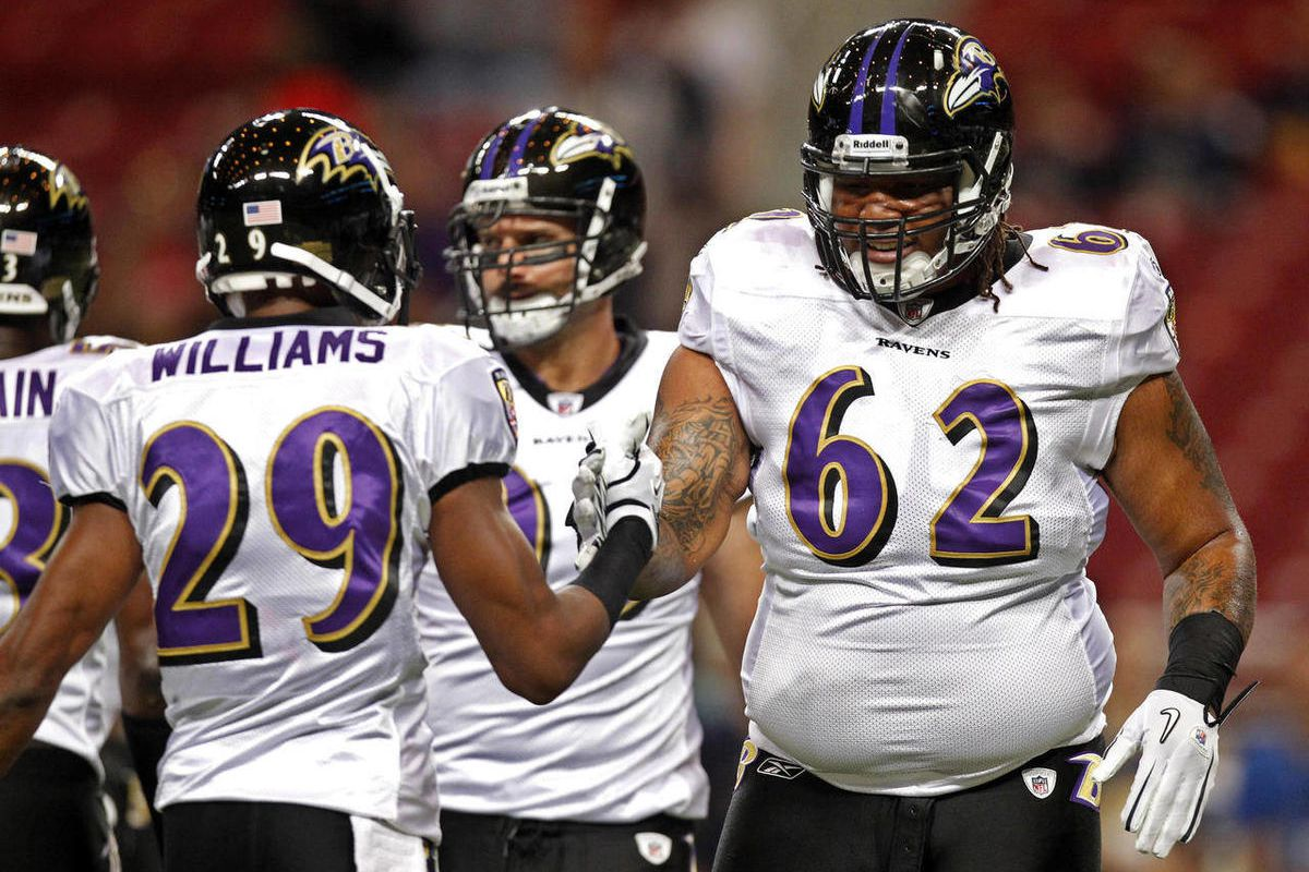 FILE - In this Sept. 25, 2011, file phot, Baltimore Ravens defensive tackle Terrence Cody, right, shakes hands with cornerback Cary Williams, left, before the start of an NFL football game against the St. Louis Rams in St. Louis. In this second year with