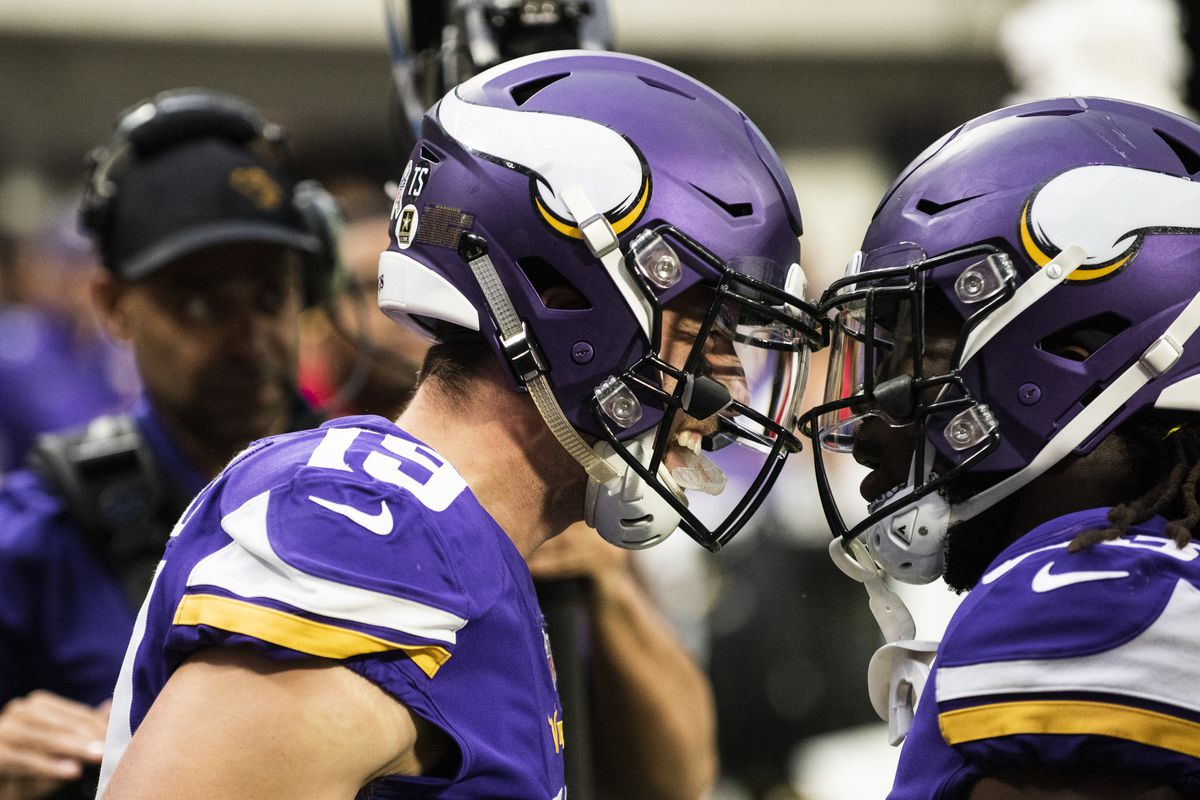 Adam Thielen of the Minnesota Vikings celebrates with teammate Dalvin Cook after catching a touchdown in the second quarter of the game against the Detroit Lions at U.S. Bank Stadium on November 4, 2018 in Minneapolis, Minnesota.