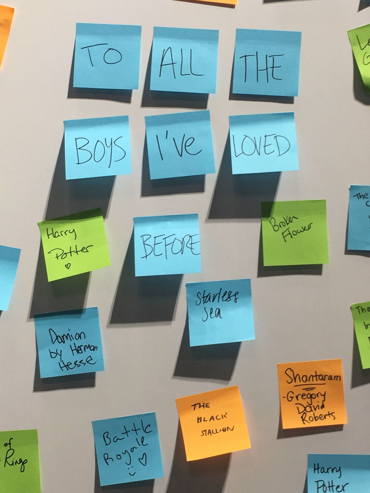 "Seven blue Post-Its name ""To all the Boys I've Loved Before"" a book that changed the Post-It-writer's life."