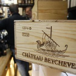 This Sept. 20, 2012, photo shows a 12-bottle wooden box of Bordeaux wine Chateau Beychevelle in a wine shop in Paris. The United States wants to sell some of their wines in the European Union with a ''chateau'' label.  Next week, EU experts will look whether it should permitted with a fight among member states set for later this year, well after the wine harvest.