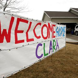 Neighbors hang signs prior to Clara Lewis' return home from the hospital in Centerville  Thursday, Dec. 29, 2011. Clara Lewis was severely injured in mid-November when her vehicle was struck by a FrontRunner train in Kaysville at a crossing.