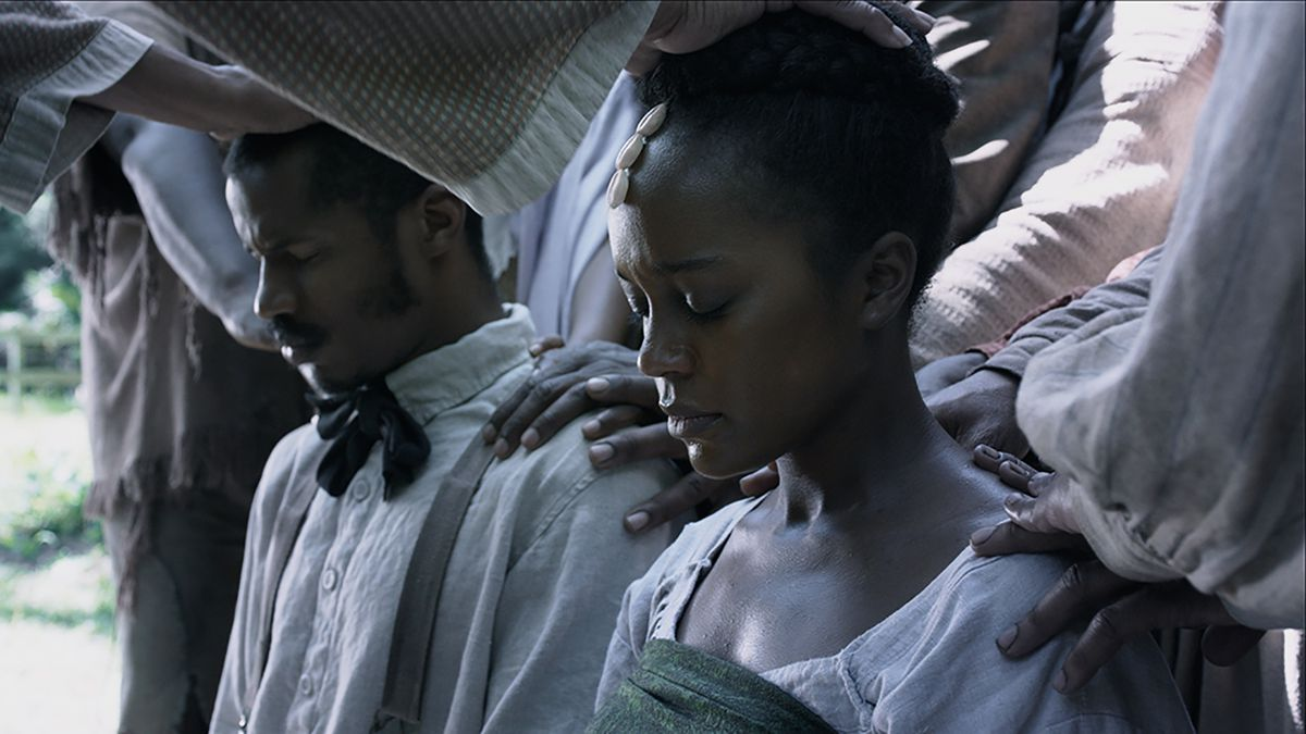 Nat and Cherry pray at their wedding in The Birth of a Nation.
