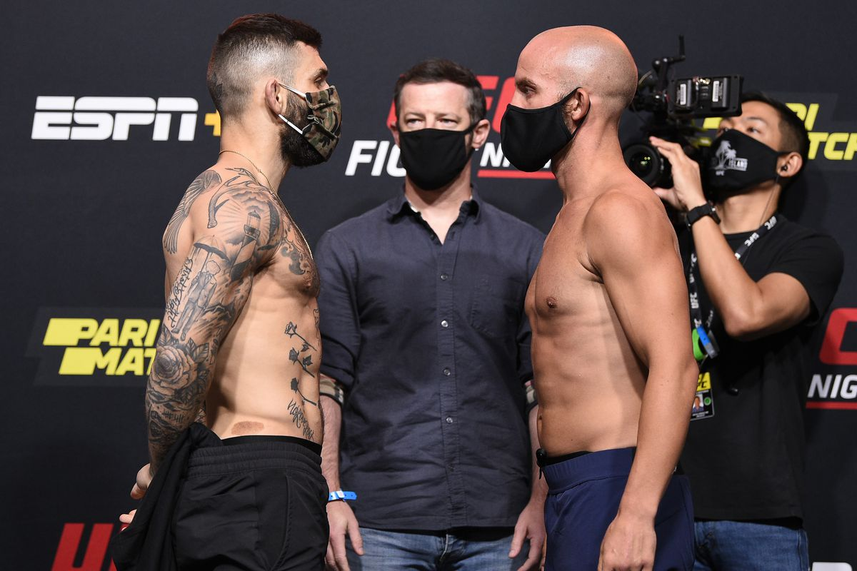 Opponents Gavin Tucker of Canada and Justin Jaynes face off during the UFC Fight Night weigh-in at UFC APEX on August 07, 2020 in Las Vegas, Nevada.