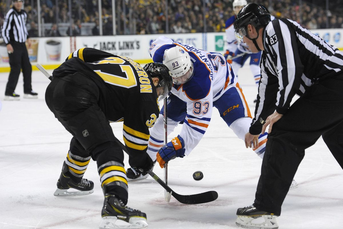 Patrice Bergeron and the Bruins face off against the Oilers