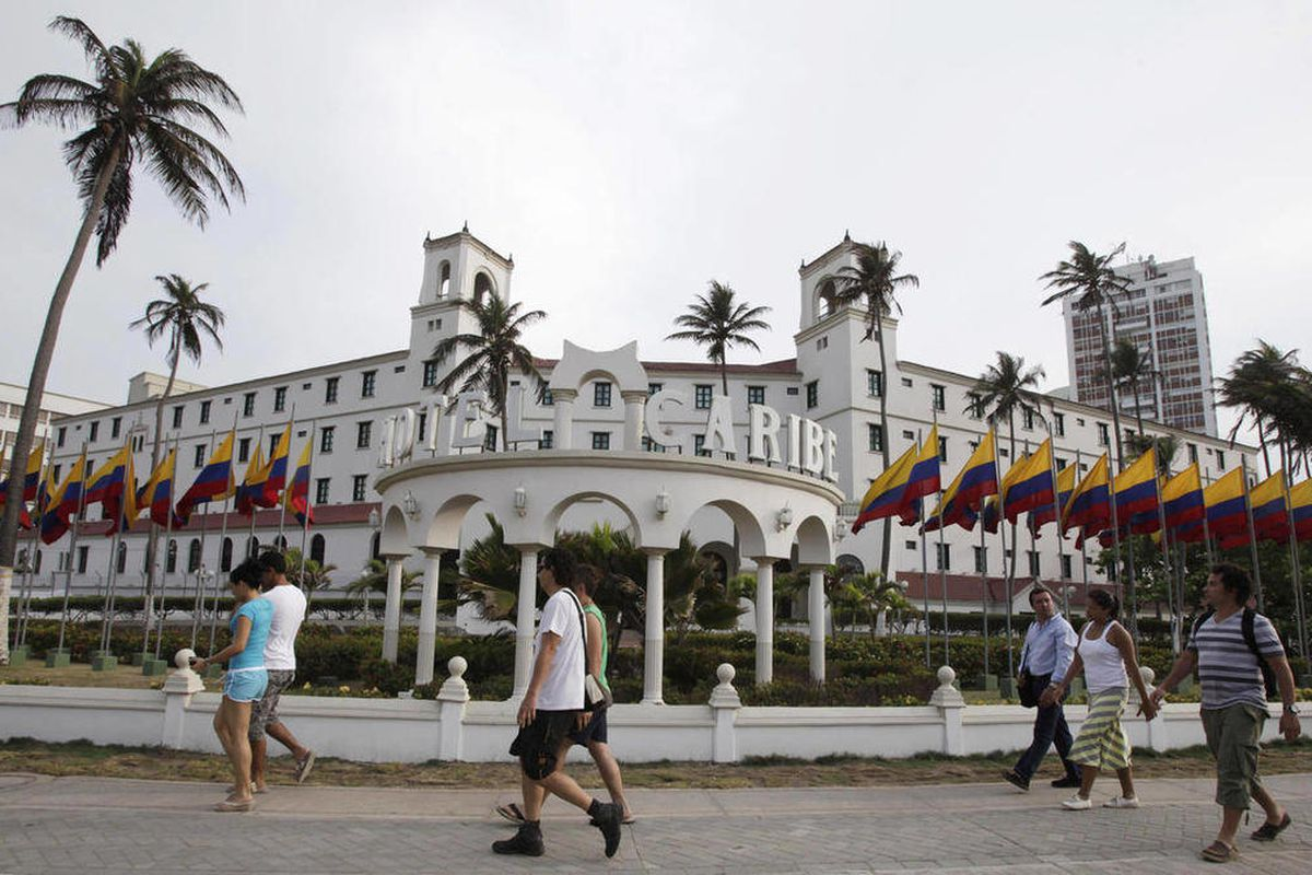 People walk past Hotel El Caribe in Cartagena, Colombia, Saturday April 14, 2012. The Secret Service sent home some of its agents for misconduct that occurred at the hotel before President Barack Obama's arrival on Friday for the Summit of the Americas.
