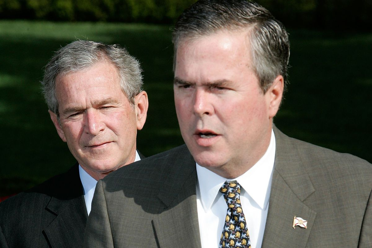 Governor Jeb Bush (D-FL) (R) speaks to the press on the war on terror as his brother US President George W. Bush looks on April 19, 2006, at the White House in Washington, DC.