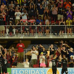 Celebrating Arriola's second goal and the game's third goal