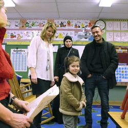 Newly arrived refugee Dania Khatib, 5, tours a classroom with her mother Mahasen Boshnaq, center rear, and father Ahmed Khatib, right, at the Northwest Primary School Friday, Jan. 27, 2017, in Rutland, Vt. The Khatib family arrived in Rutland this month.