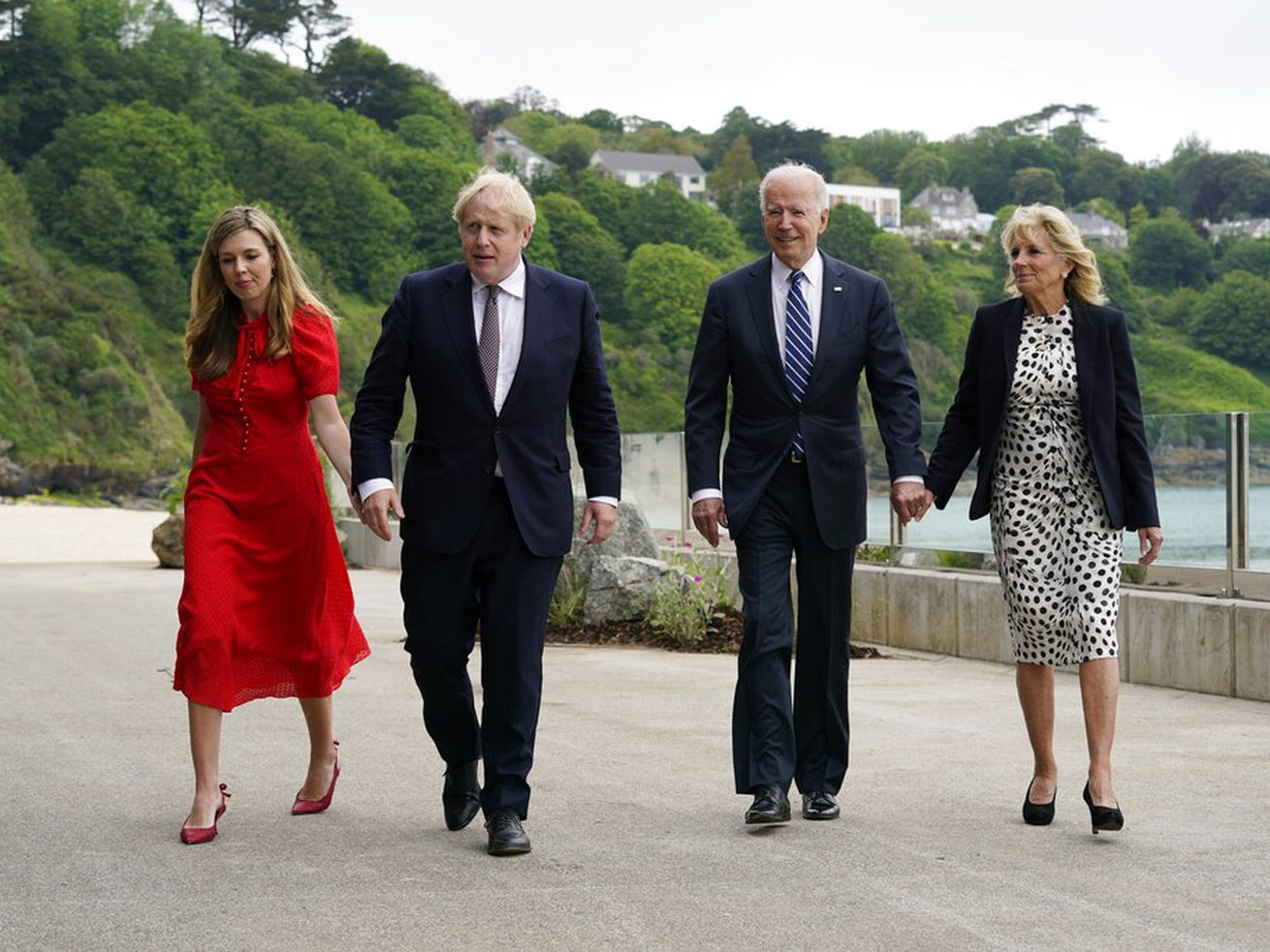 President Joe Biden and first lady Jill Biden walk with British Prime Minister Boris Johnson and his wife, Carrie Johnson.