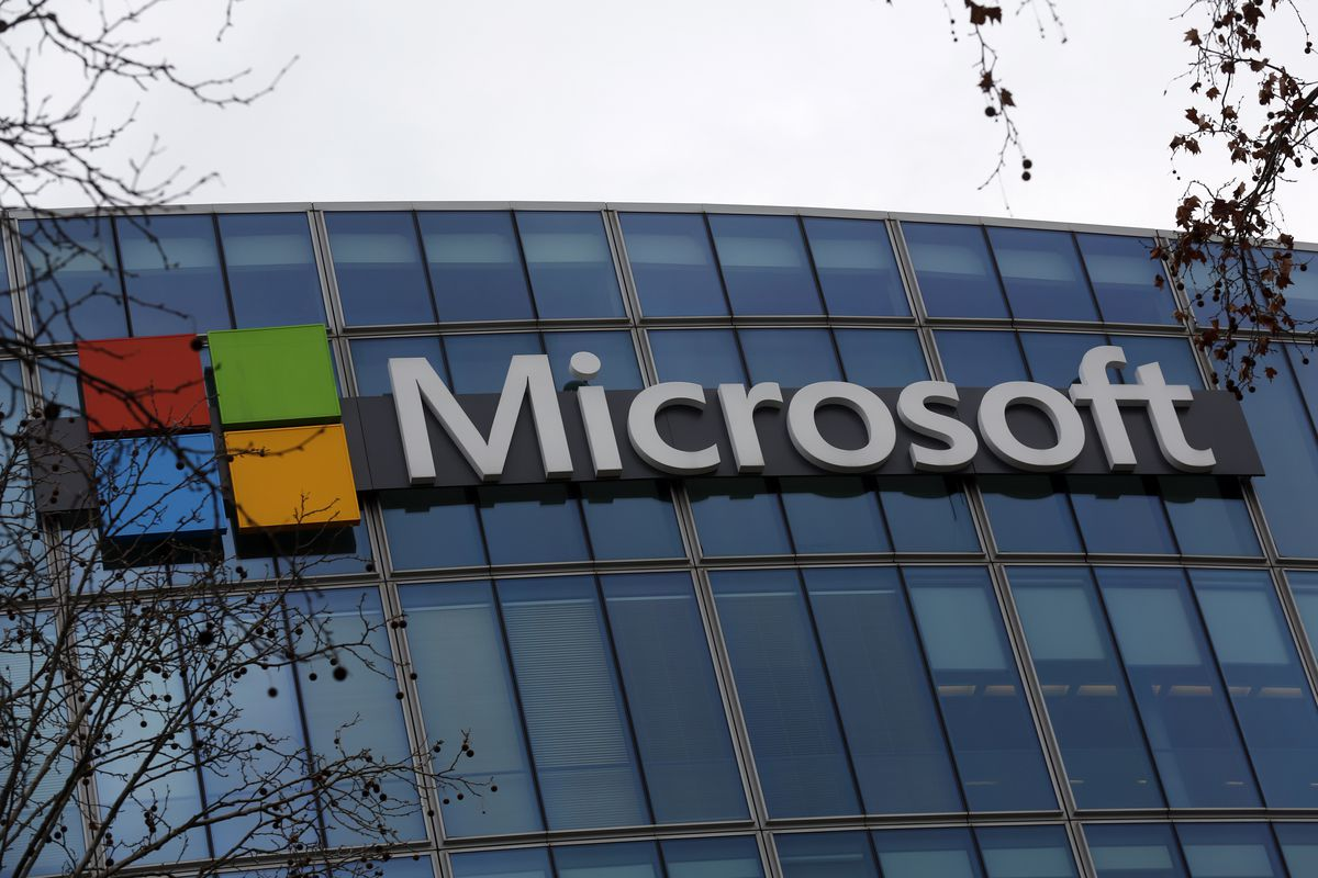The logo of Microsoft displayed outside the headquarters in Paris. Microsoft is ditching the default Calibri font from its Microsoft Office products. It needs your help to pick a new one.