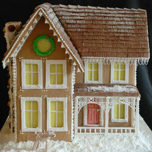 Old Kentucky home style gingerbread house with red door.