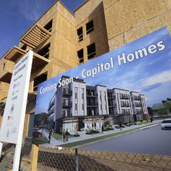 Construction continues on Capitol Homes Apartments, a mixed-income, mixed-use development at 1749 S. State in Salt Lake City on Wednesday, Dec. 9, 2020.