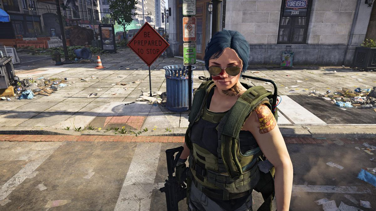 The Division 2 - a player character poses near a sign