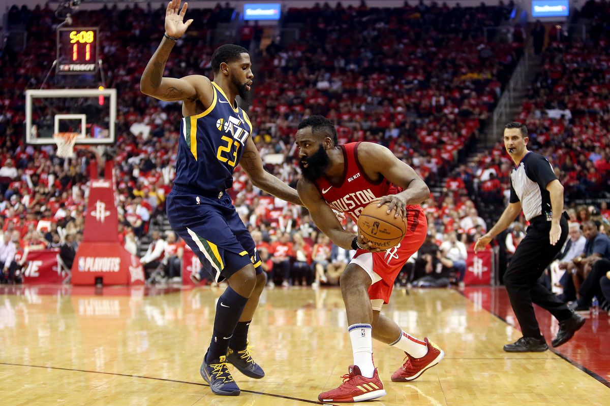Utah Jazz forward Royce O'Neale (23) does his best to stay with Houston Rockets guard James Harden (13) as the Utah Jazz and the Houston Rockets play in game 2 of the NBA Western Conference playoffs at the Toyota Center in Houston Texas on Wednesday, Apri