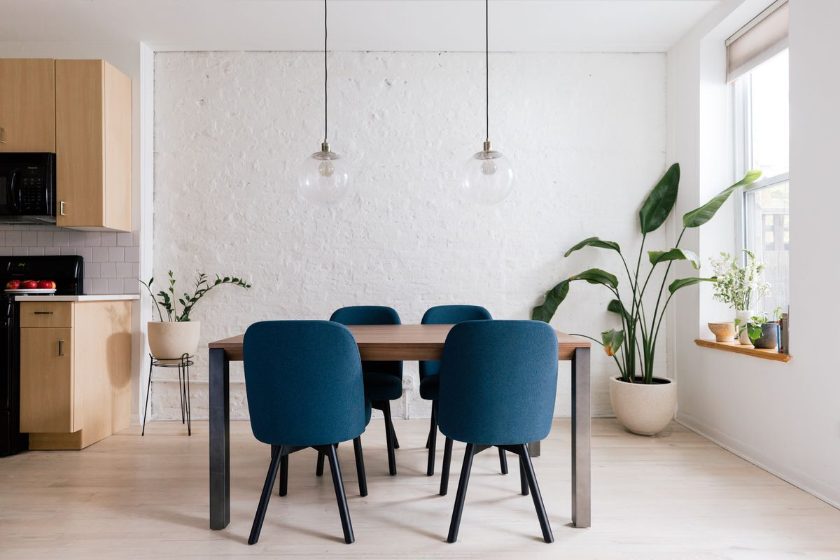 modern dining table and upholstered chairs
