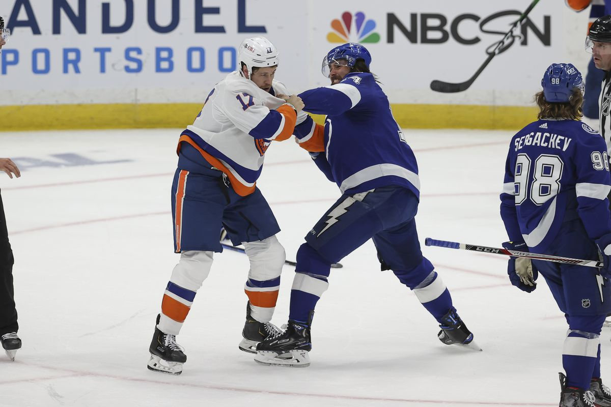 Tampa Bay Lightning left wing Pat Maroon (14) and New York Islanders left wing Matt Martin (17) fight in the first period of Game 2 of the Stanley Cup Playoffs Semifinals between the New York Islanders and Tampa Bay Lightning on June 15, 2021 at Amalie Arena in Tampa, FL.