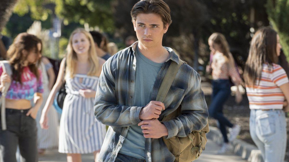 a boy in a flannel jacket