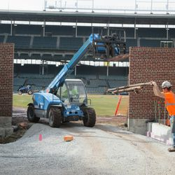 Bleacher wall braces being removed from the field -