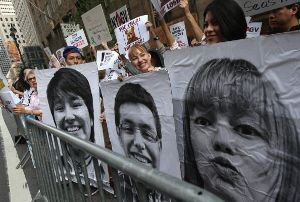 faces at immigration protest