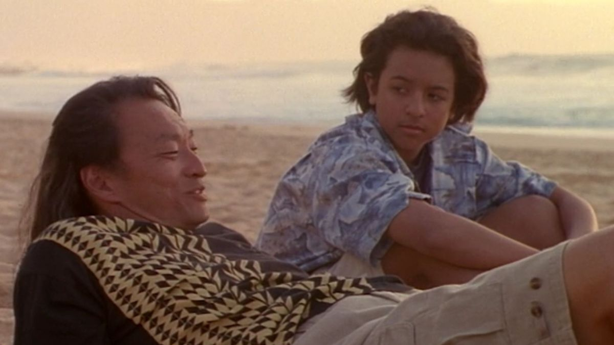 Johnny Tsunami and his grandfather chill on the beach during sunset
