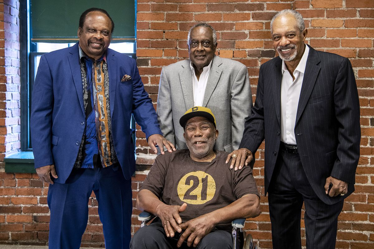 Al Oliver, Gene Clines, Manny Sanguillen, seated, and Dave Cash pose for a portrait during an event hosted by the Pittsburgh Pirates to celebrate the 50th anniversary of the first all-minority lineup to take the field in Major League Baseball history.