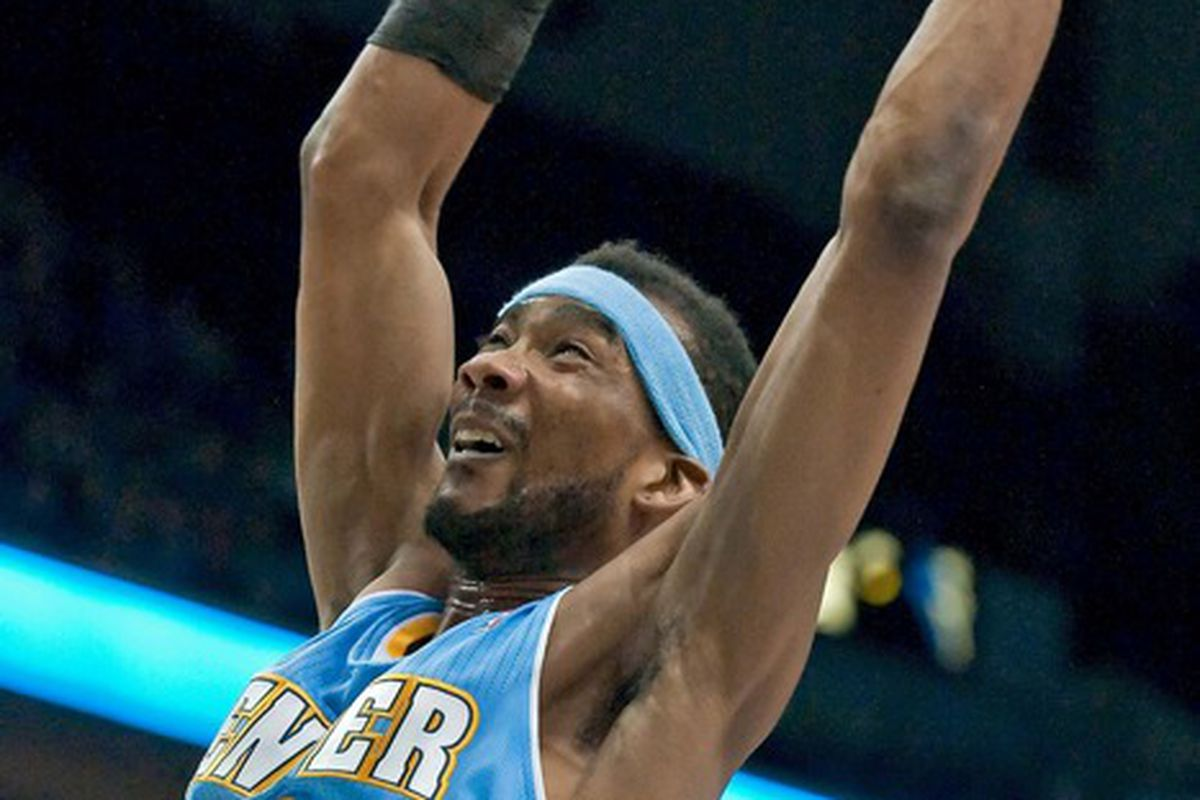 Apr 26, 2012; Minneapolis, MN, USA; Denver Nuggets small forward Corey Brewer (13) dunks against the Minnesota Timberwolves during the first quarter at Target Center. Nuggets won 131-102. Mandatory Credit:  Greg Smith-US PRESSWIRE