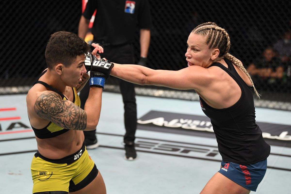 Katlyn Chookagian punches Jessica Andrade of Brazil in their women's flyweight bout during the UFC Fight Night event inside Flash Forum on UFC Fight Island on October 18, 2020 in Abu Dhabi, United Arab Emirates.