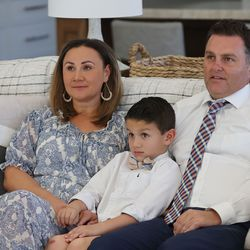 Thomas and Mandi Godfrey and their son, Wyatt, watch the morning session of the 191st Annual General Conference of The Church of Jesus Christ of Latter-day Saints from their home in Holladay on Saturday, April 3, 2021.
