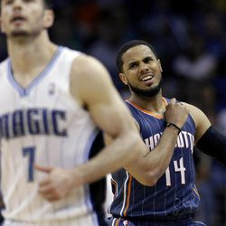 Charlotte Bobcats' D.J. Augustin (14) reacts after missing a shot as he chases Orlando Magic's J.J. Redick (7) downcourt during the second half of an NBA basketball game, Wednesday, April 25, 2012, in Orlando, Fla. Orlando won 102-95.