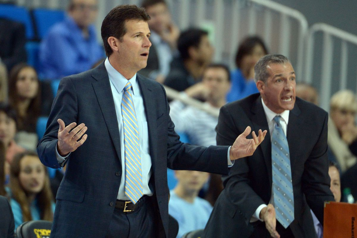 Assistant Coach Ed Schilling(right) filled in for an ailing Steve Alford at Today's Media Availability