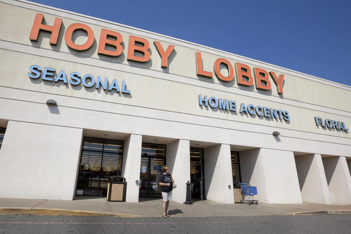 A woman walks from a Hobby Lobby Inc., store in Little Rock, Ark., Wednesday, Sept. 12, 2012. The Oklahoma City-based chain filed a federal lawsuit Wednesday over a mandate in the health reform law that requires employers to provide coverage for the morni