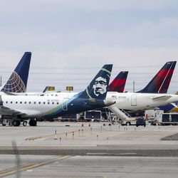 Planes are parked at their gates at the Salt Lake City International Airport on Wednesday, March 18, 2020, after a 5.7 magnitude earthquake centered in Magna caused the airport to be evacuated and closed.