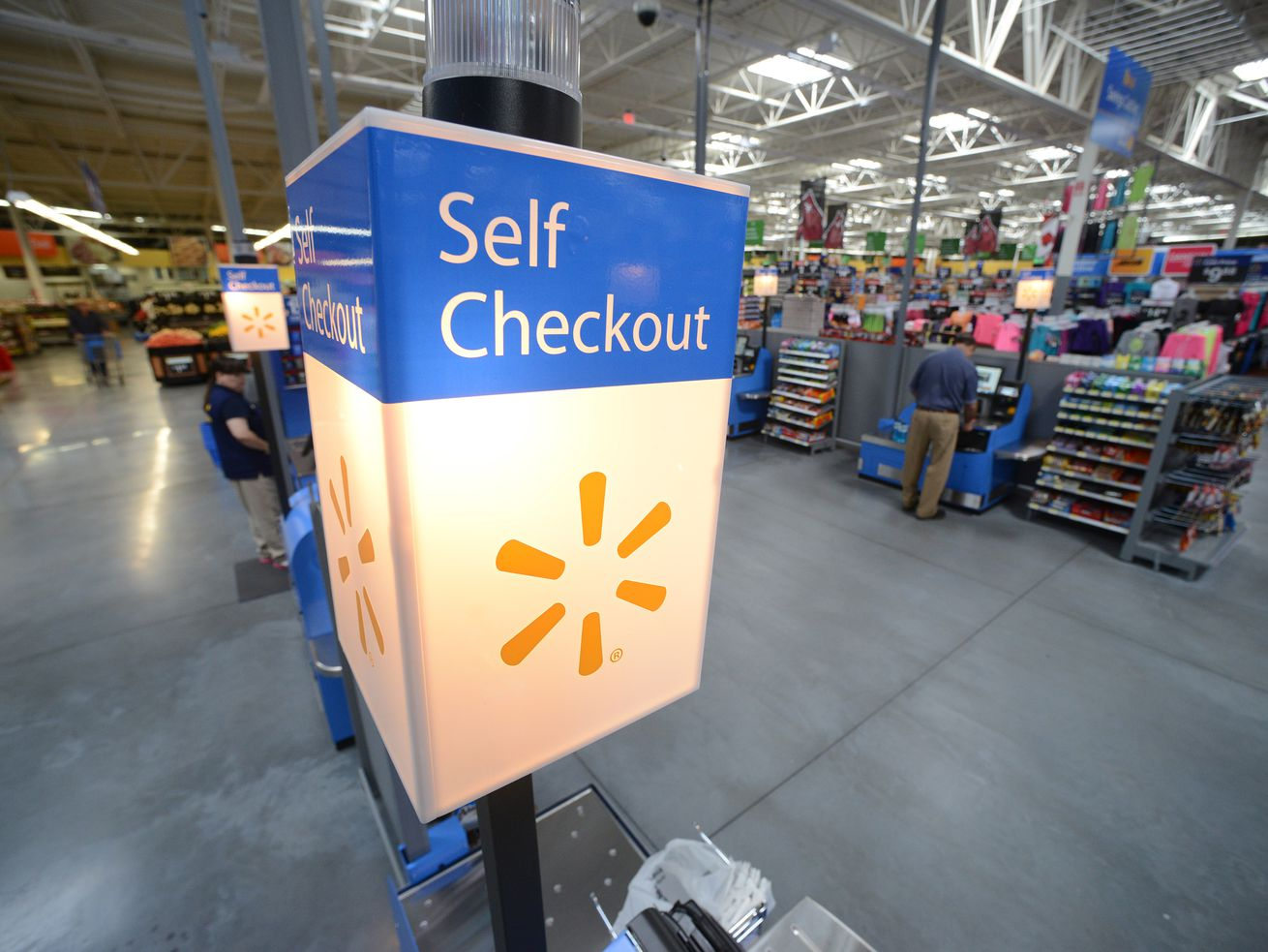 Walmart will test out giant self-checkout stations that could eliminate cashiers completely.