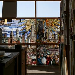 """Panels of art glass that will make up """"The Roots of Knowledge,"""" a 200-foot-long stained glass installation for Utah Valley University, hang in the window at Holdman Studios in Lehi on Friday, Nov. 4, 2016. A Guardian UK reporter called the work """"one of the most spectacular stained glass windows made in the past century."""""""