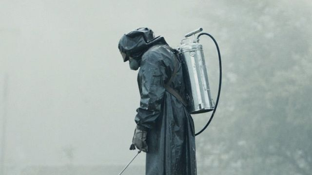 a man in a hazmat suit cleans up chernobyl in HBO's Chernobyl
